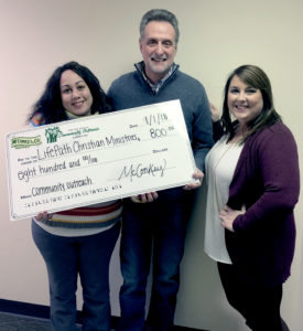 McConkey - Holding Check for Community Outreach